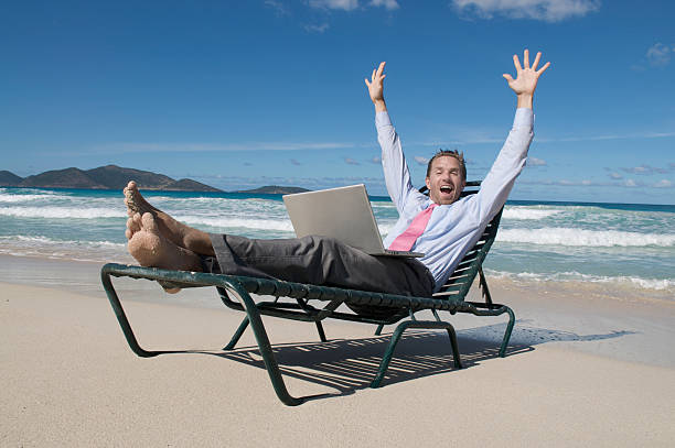 Businessman Celebrates from his Beach Chair stock photo