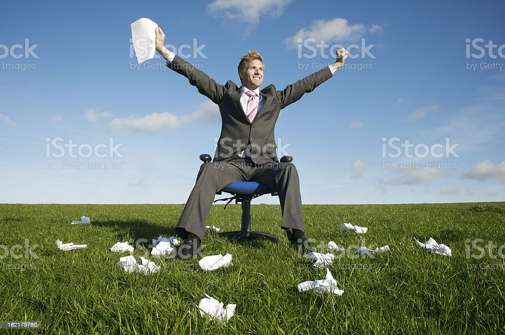 Businessman Celebrating in Meadow Holding Paper royalty-free stock photo