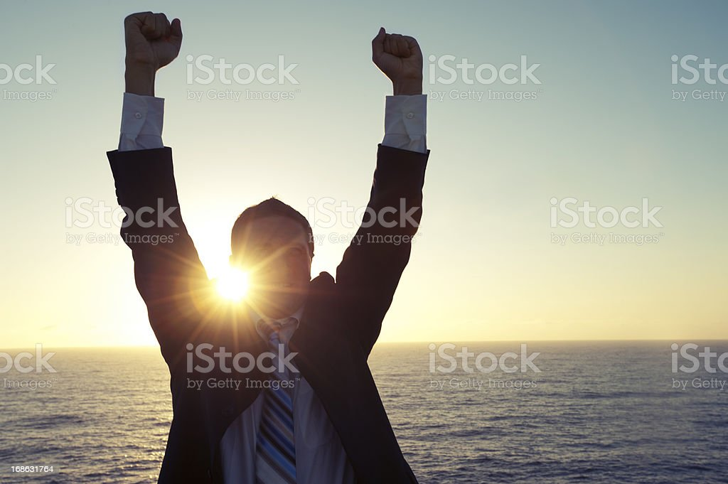 Businessman celebrating stock photo