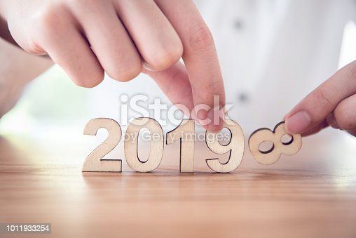 istock Businessman change wood text 2018 to new year 2019. 1011933254