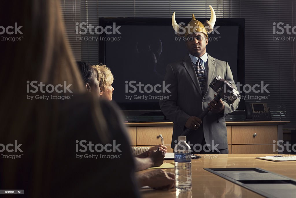 Businessman channeling his inner warrior. stock photo