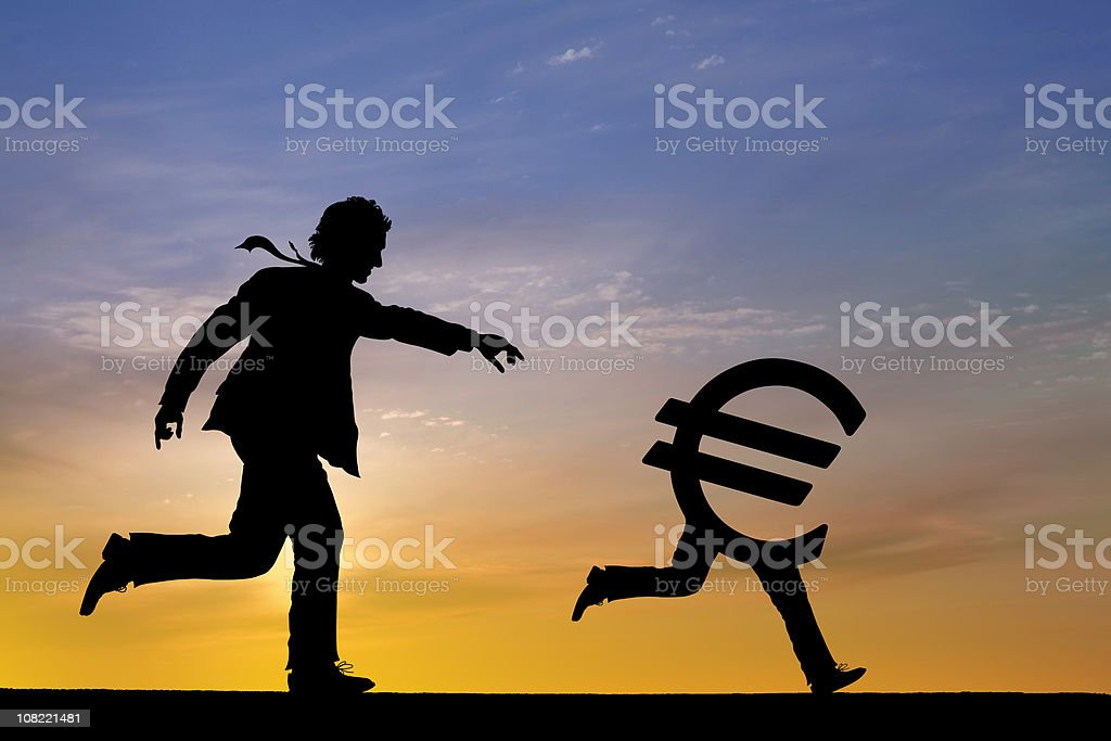 Businessman chasing Euro Currency Sign royalty-free stock photo