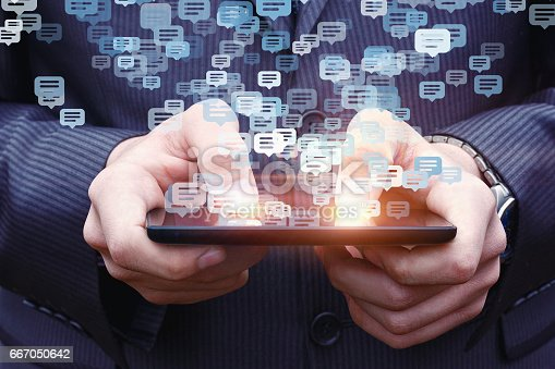 istock Businessman chatting on a cell phone. 667050642