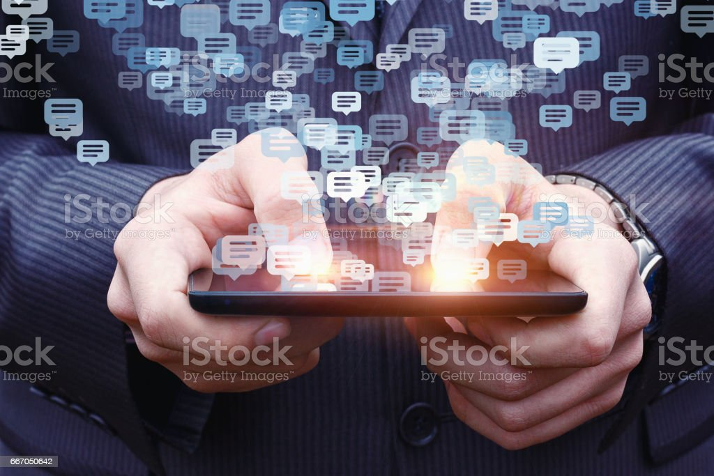 Businessman chatting on a cell phone. stock photo