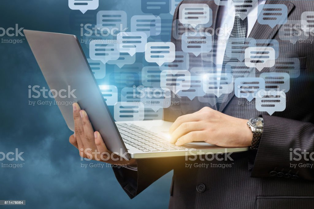 Businessman chatting on a laptop . stock photo