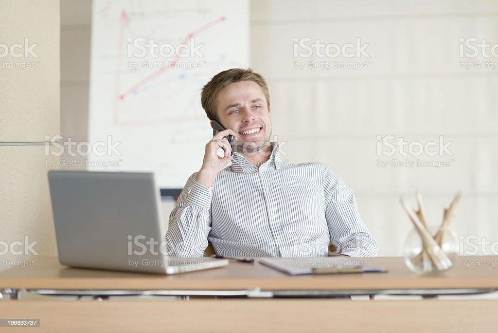 Businessman chatting on phone stock photo
