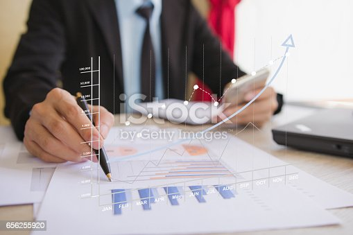 istock Businessman check business profits 656255920
