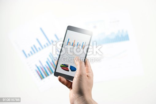 istock Businessman check data in smartphone 910616766