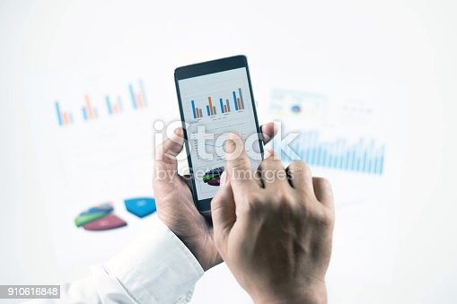istock Businessman check data in smartphone 910616848
