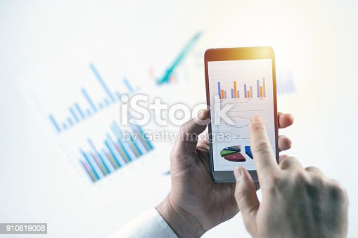 istock Businessman check data in smartphone 910619008
