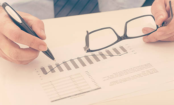Businessman checking a business report stock photo