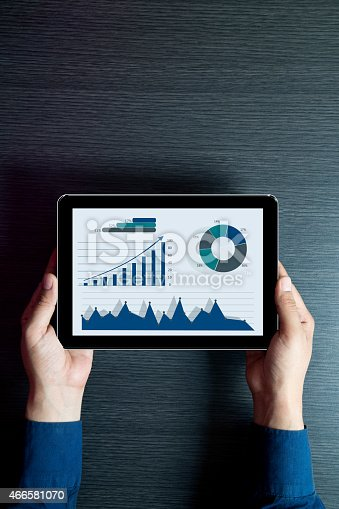 istock Businessman checking business reports on digital tablet 466581070