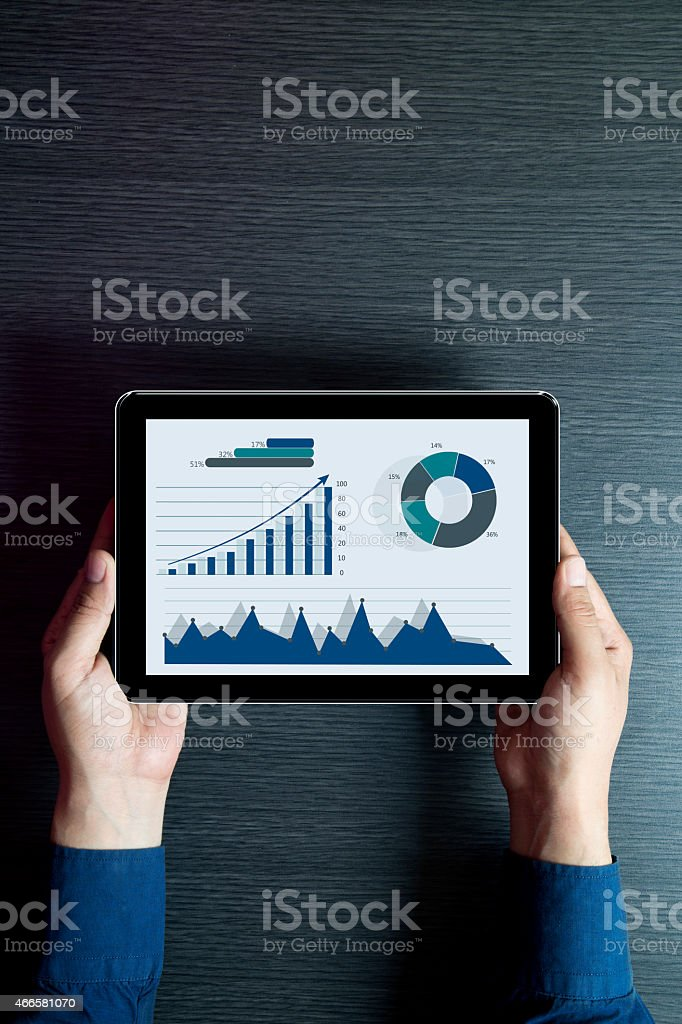 Businessman checking business reports on digital tablet stock photo