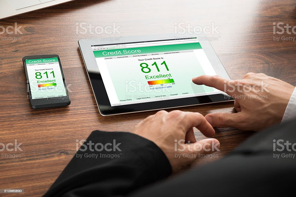Businessman Checking Credit Score stock photo