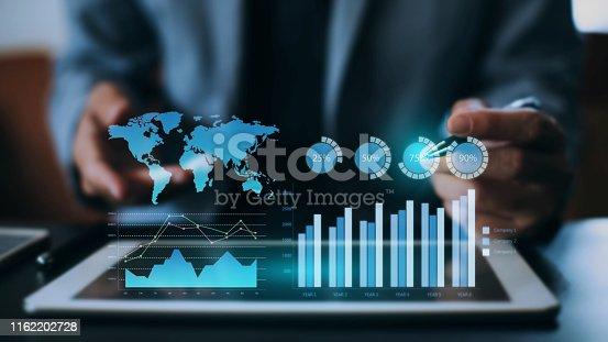 istock businessman checking digital data by virtual reality. 1162202728