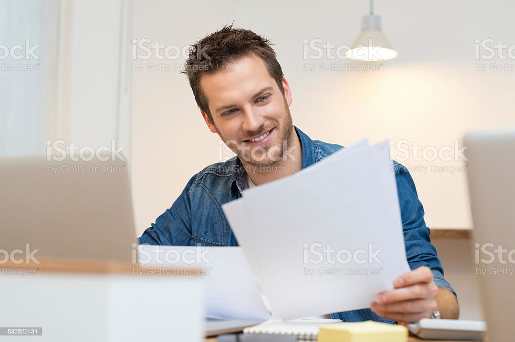 Businessman checking document stock photo