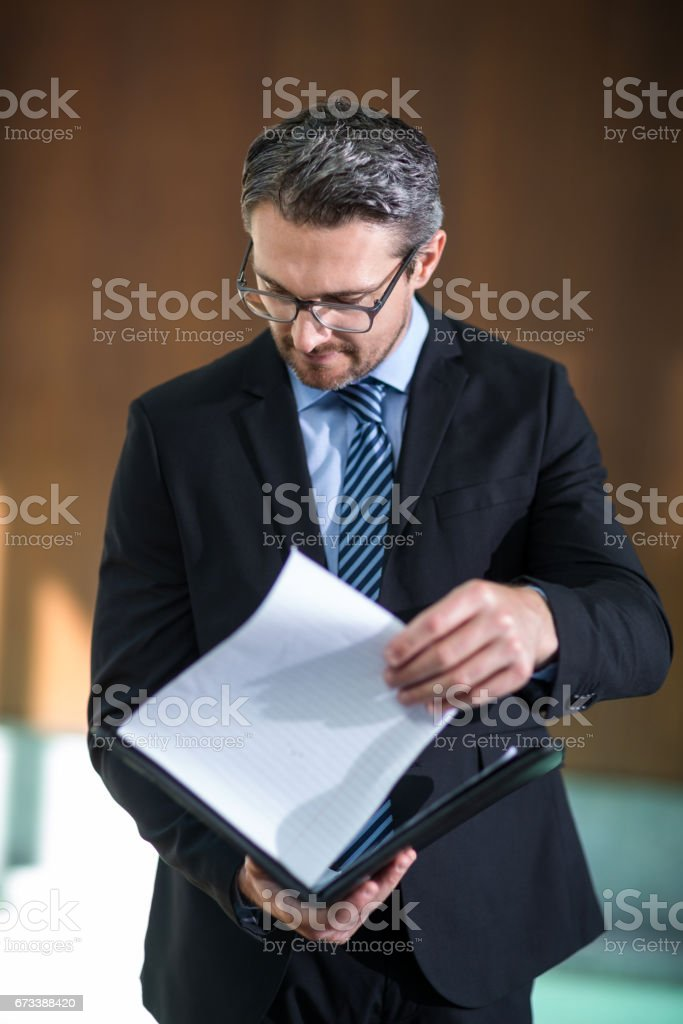 Businessman checking his document stock photo