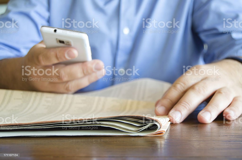 Businessman checking his share of stocks in the newspaper. stock photo