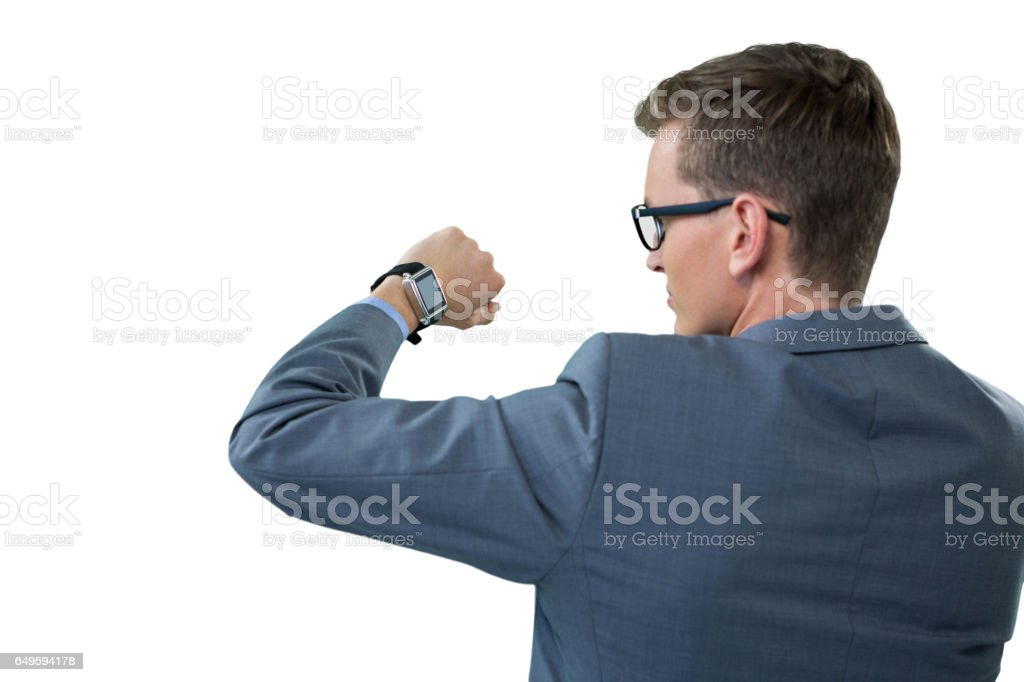 Businessman checking his smart watch stock photo