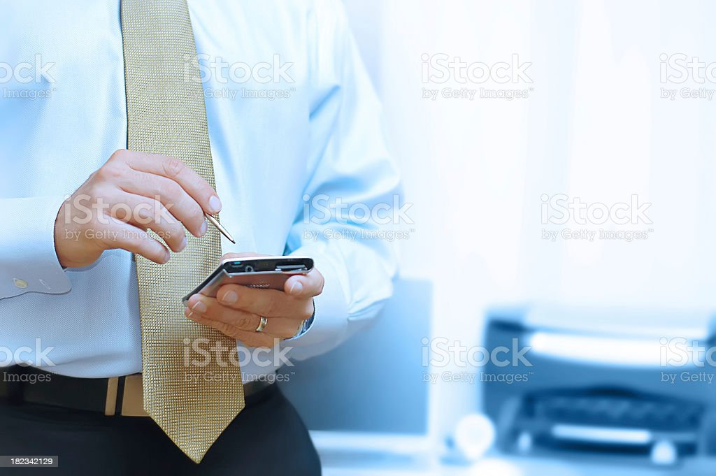 Businessman checking his smartphone royalty-free stock photo