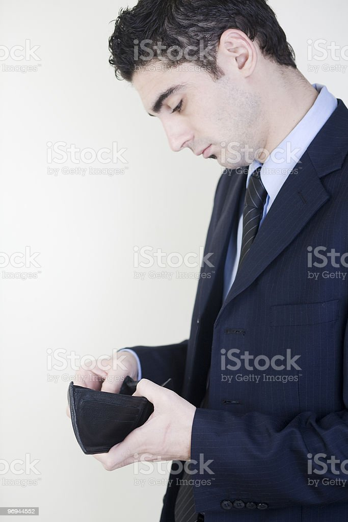 Businessman checking his wallet royalty-free stock photo