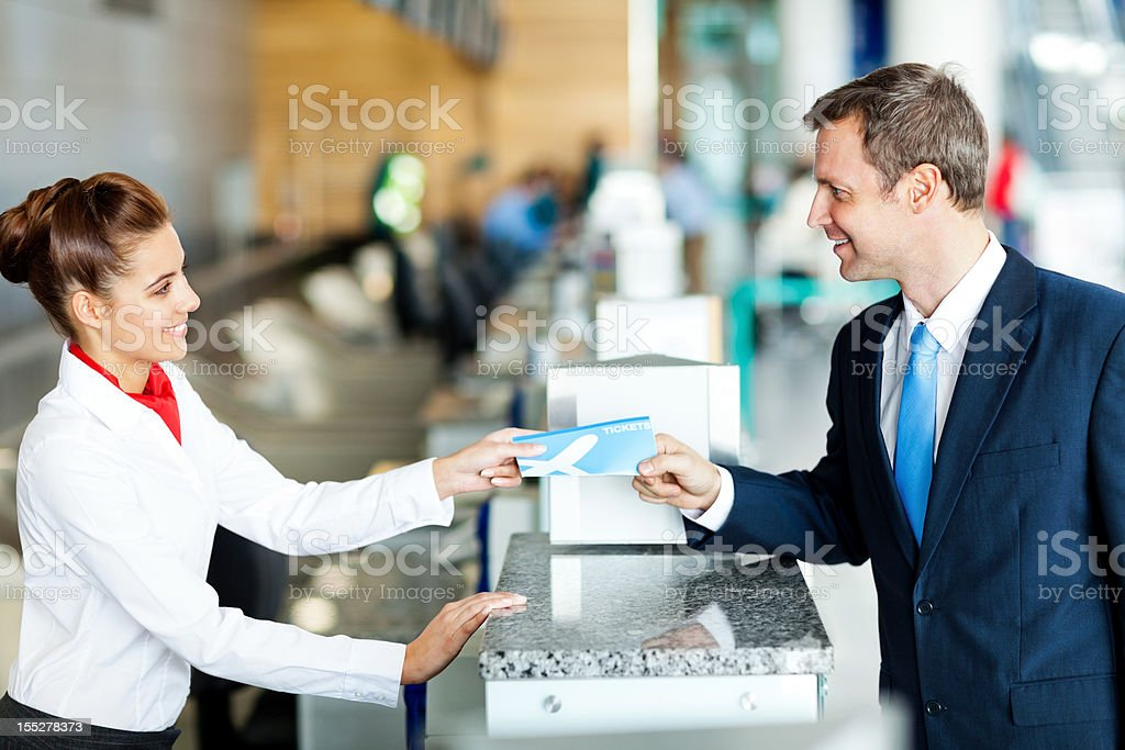 Businessman Checking in at the Airport royalty-free stock photo