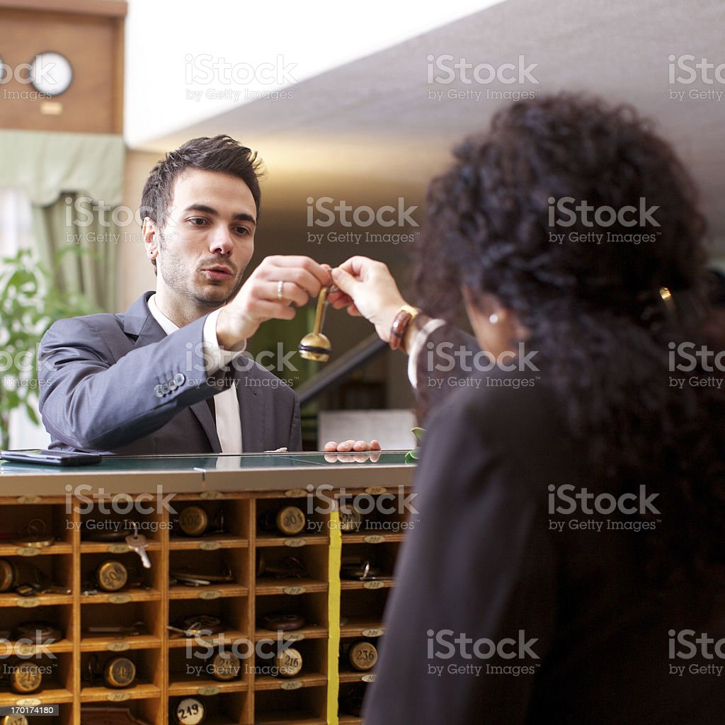 Businessman checking in to a hotel royalty-free stock photo