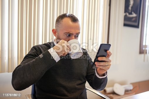 istock Businessman checking mail on a smart phone 1137618612