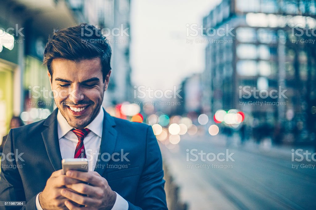 Businessman checking messages stock photo
