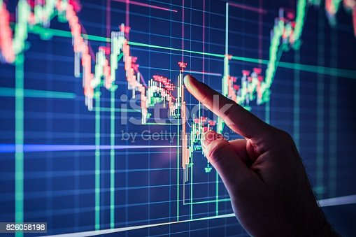 istock Businessman checking stock market data. 826058198