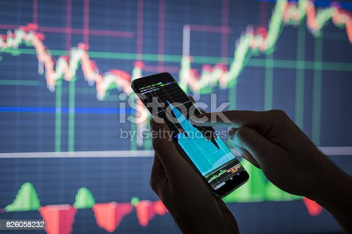 istock Businessman checking stock market data. 826058232