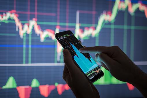 istock Businessman checking stock market data. 826058232