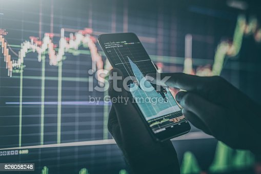 istock Businessman checking stock market data. 826058248