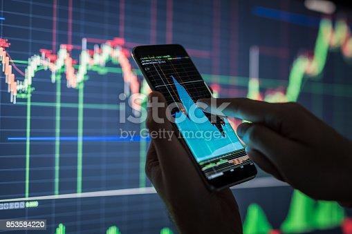 826058232istockphoto Businessman checking stock market data. 853584220