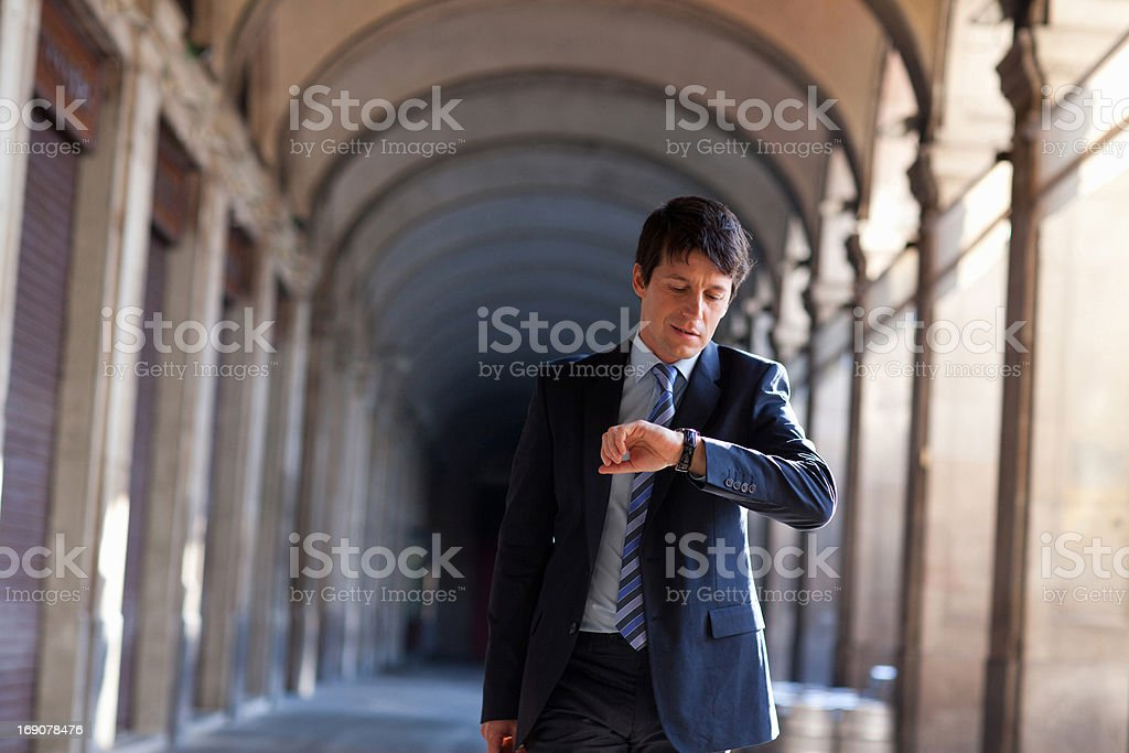 Businessman checking the time outdoors royalty-free stock photo