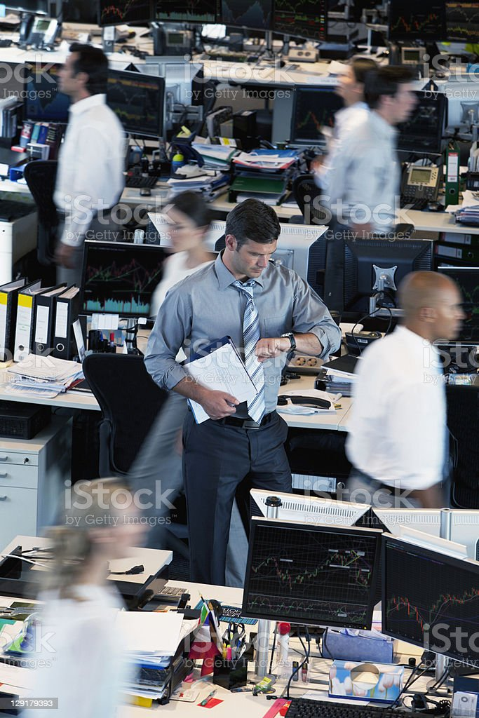 Businessman checking the time stock photo
