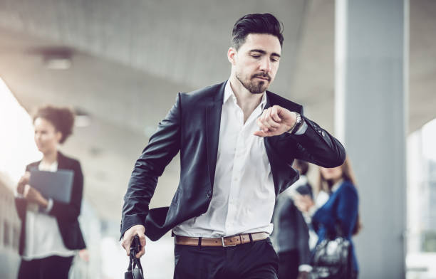 businessman checking the time - after work stock photos and pictures