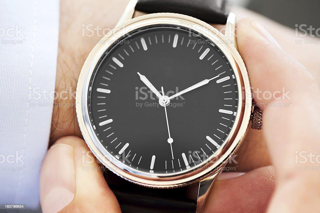 Businessman Checking Time stock photo