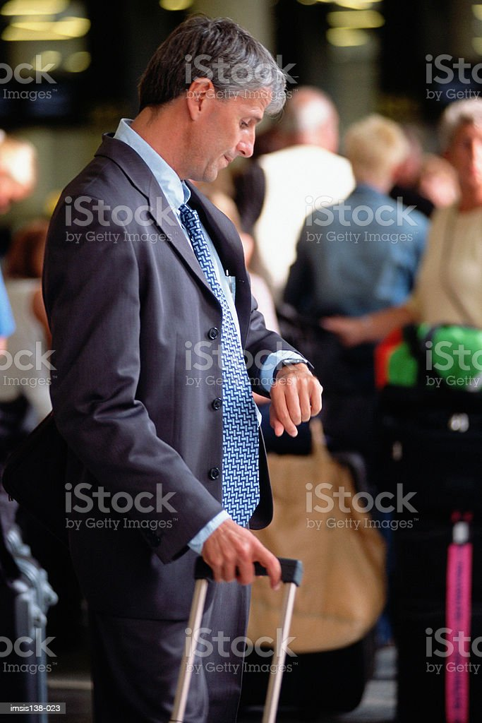 Businessman checking time royalty-free stock photo