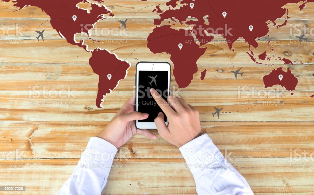 Businessman checking world map with plane on phon. Travel and tourism concept. Airplane route. royalty-free stock photo