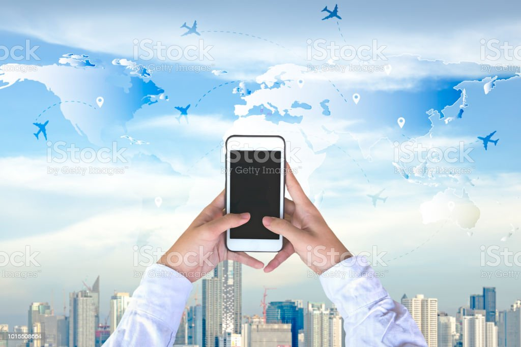 Businessman checking world map with plane on phone travel and businessman checking world map with plane on phone travel and tourism concept city background gumiabroncs Choice Image