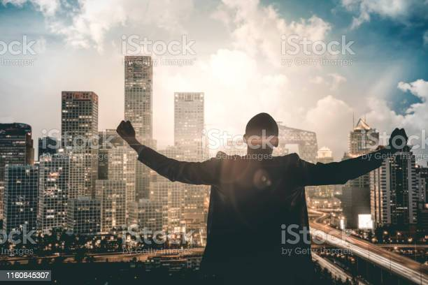 Businessman cheering achievement in downtown beijing picture id1160645307?b=1&k=6&m=1160645307&s=612x612&h=81dosb4h2lpodijc bbn2bj0kbbtpkbg1atzll wzbu=