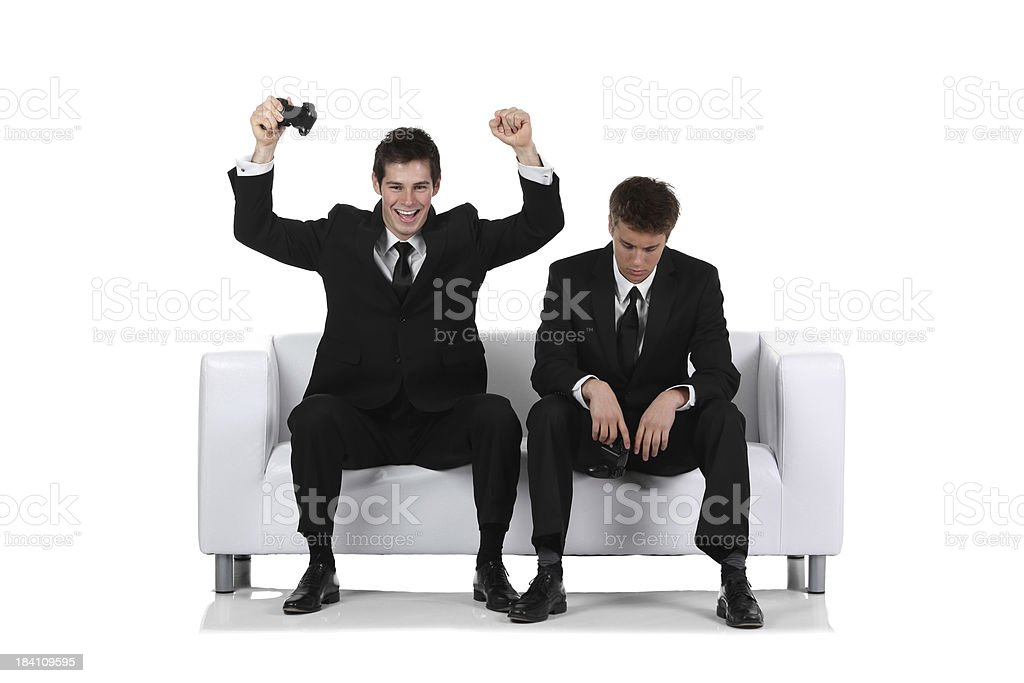 Businessman cheering after winning a video game royalty-free stock photo