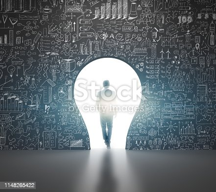 istock Businessman choising a life andwalking a light bulb entering - Business ideas 1148265422