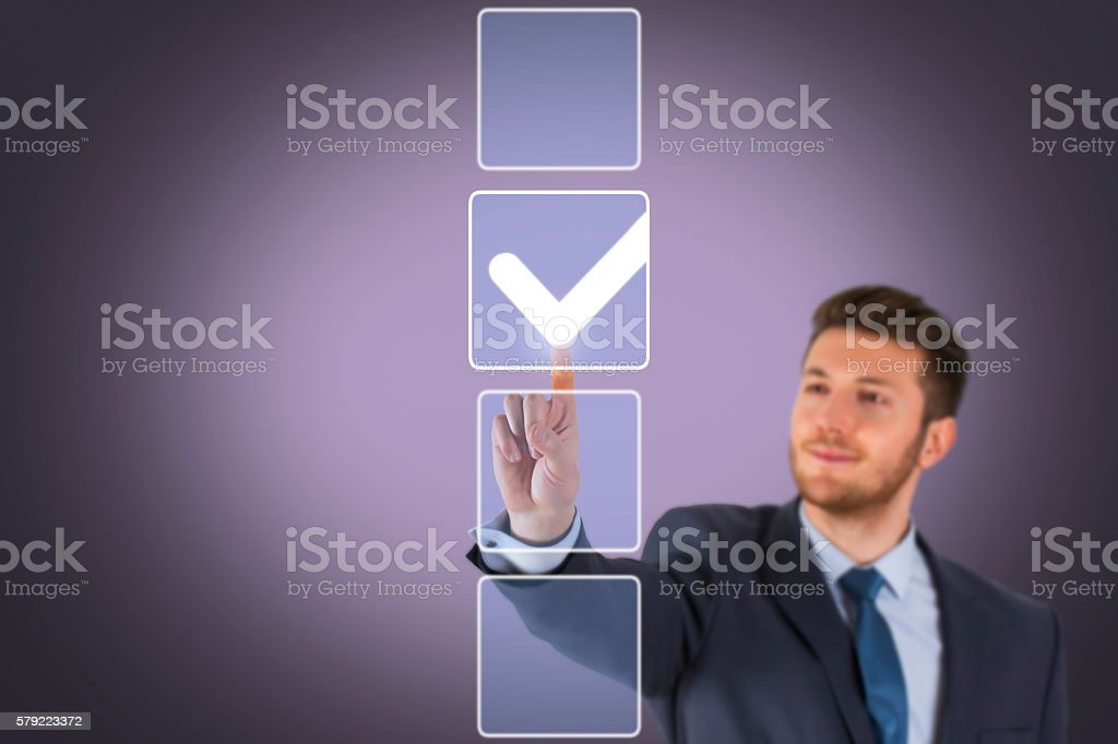 Businessman Choose Check List on Touch Screen stock photo