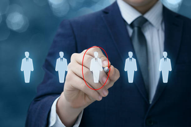 Businessman chooses the employee . Businessman chooses the employee on a virtual screen. military recruit stock pictures, royalty-free photos & images