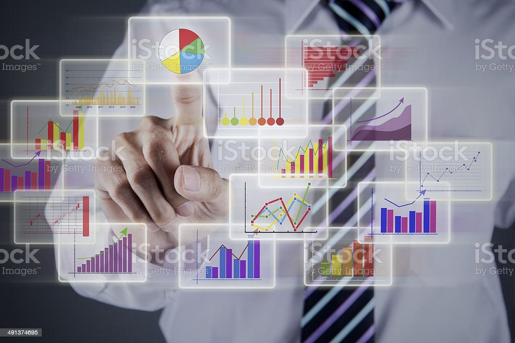 Businessman choosing chart on business interface stock photo