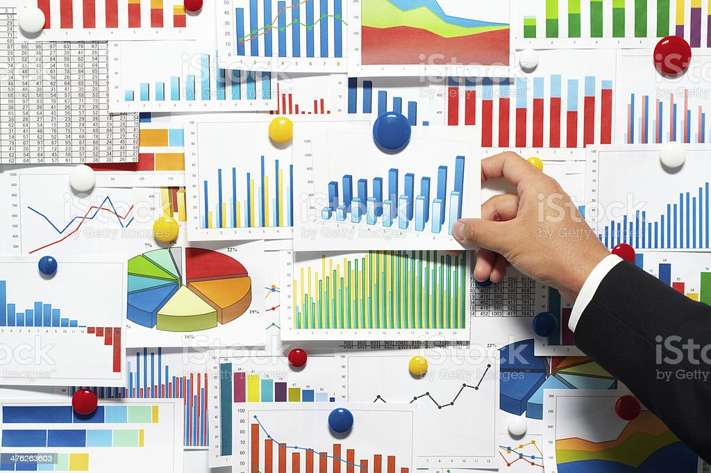 Businessman choosing from a variety of graphs. royalty-free stock photo