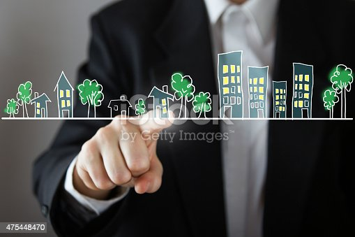 885968454 istock photo Businessman choosing house, real estate concept. 475448470