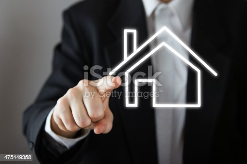 885968454 istock photo Businessman choosing house, real estate concept. 475449358